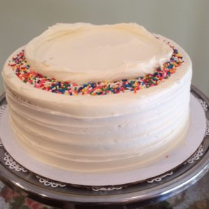Vanilla icing which includes sprinkles.