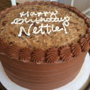 German chocolate icing with a 3 word inscription.