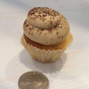 Mini cupcake size compared to a quarter.  It's a cute single bite!