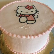 This cake has a pink vanilla buttercream icing with smooth frosted top and sides and a custom computer print of Hello Kitty.
