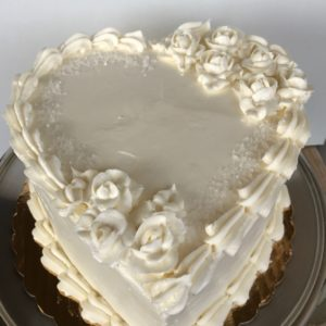 Classic design for an engagement, anniversary, or a romanic occasion.  This cake includes the addition of rose clusters.